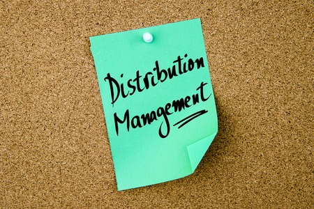 distribution board: Distribution Management written on green paper note pinned on cork board with white thumbtacks, copy space available Stock Photo