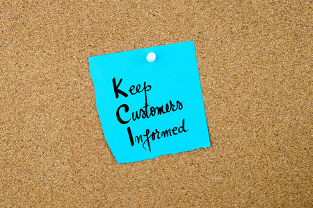 informed: Business Acronym  KCI Keep Customers Informed written on blue paper note pinned on cork board with white thumbtack, copy space available