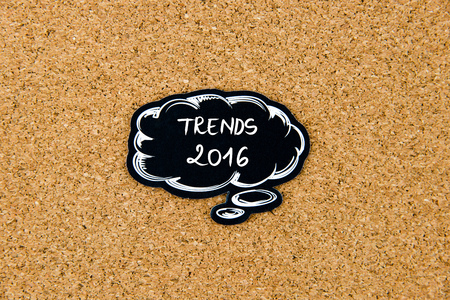 marking up: TRENDS 2016 written on black thinking bubble over cork board background, copy space available Stock Photo