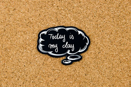 marking up: Today Is My Day written on black thinking bubble over cork board background, copy space available