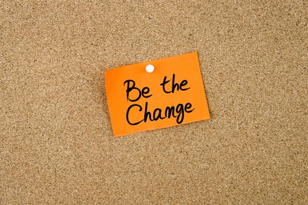 be the change: Be The Change written on orange paper note pinned on cork board with white thumbtacks, copy space available Stock Photo