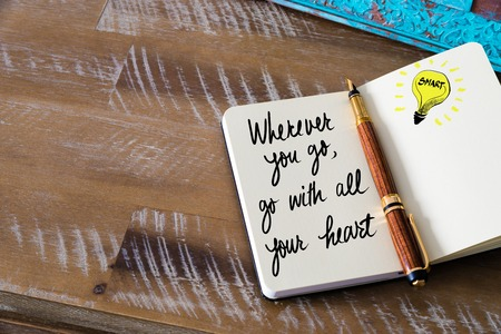 wherever: Handwritten text Wherever you Go, Go With All Your Heart with fountain pen on notebook. Concept image with copy space available.