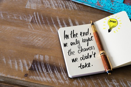 regret: Handwritten text In the end, we only regret the chances we didn�t take with fountain pen on notebook. Concept image with copy space available.