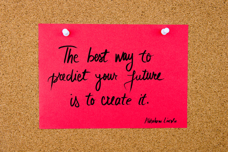 best way: Quote The Best Way To Predict Your Future Is To Create It by Abraham Lincoln, written on red paper note pinned on cork board with white thumbtacks, copy space available Stock Photo