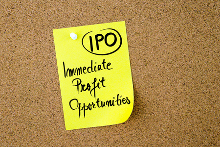 immediate: Business Acronym IPO Immediate Profit Opportunities written on yellow paper note pinned on cork board with white thumbtack, copy space available Stock Photo