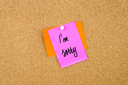 i am: I Am Sorry written on paper note pinned on cork board with white thumbtack, copy space available Stock Photo