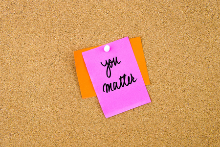 matter: You Matter written on paper note pinned on cork board with white thumbtack, copy space available