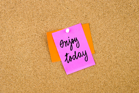 enjoy space: Enjoy Today written on paper note pinned on cork board with white thumbtack, copy space available