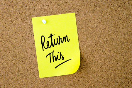 this: Return This written on yellow paper note pinned on cork board with white thumbtack, copy space available