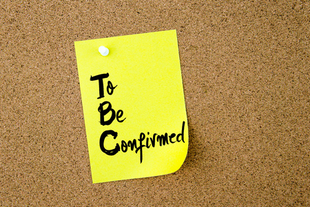 confirmed: Business Acronym  TBC To Be Confirmed written on yellow paper note pinned on cork board with white thumbtack, copy space available Stock Photo