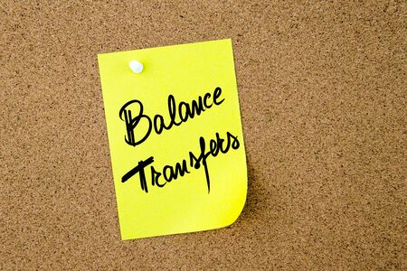 transfers: Business Acronym BT as Balance Transfers written on yellow paper note pinned on cork board with white thumbtack, copy space available