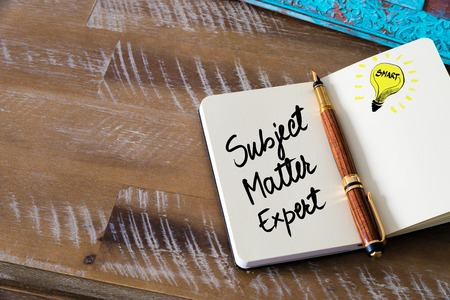 Handwritten text Subject Matter Expert with fountain pen on notebook. Concept image with copy space available.