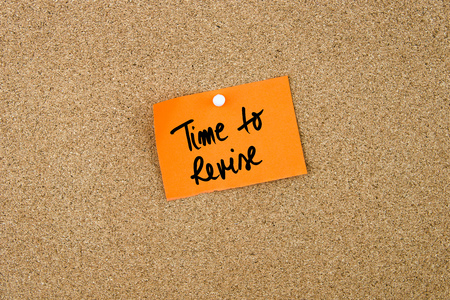 revise: Time To Revise written on orange paper note pinned on cork board with white thumbtacks, copy space available Stock Photo