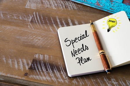 Handwritten text Special Needs Plan with fountain pen on notebook. Concept image with copy space available.