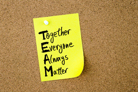business matter: Business Acronym TEAM as Together Everyone Always Matter written on yellow paper note pinned on cork board with white thumbtack, copy space available