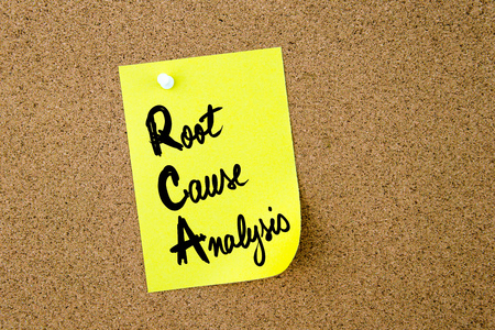 rca: Business Acronym RCA Root Cause Analysis written on yellow paper note pinned on cork board with white thumbtack, copy space available