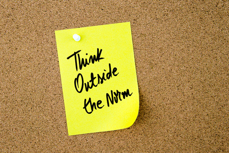 norm: Think Outside The Norm written on yellow paper note pinned on cork board with white thumbtack, copy space available Stock Photo