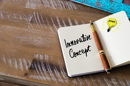 innovative concept: Handwritten text Innovative Concept with fountain pen on notebook. Concept image with copy space available. Stock Photo