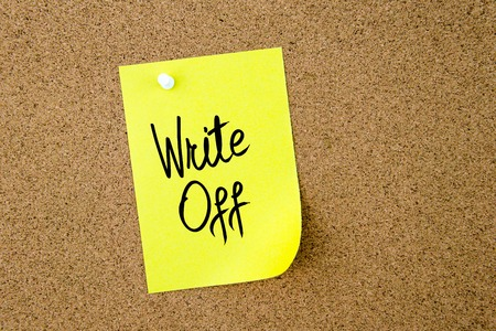 write off: Write Off written on yellow paper note pinned on cork board with white thumbtack, copy space available Stock Photo