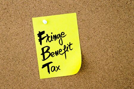 fringe benefit: Business Acronym FBT Fringe Benefit Tax written on yellow paper note pinned on cork board with white thumbtack, copy space available Stock Photo