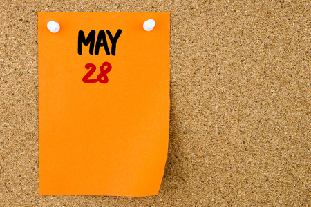 28: 28 MAY written on orange paper note pinned on cork board with white thumbtacks, copy space available Stock Photo