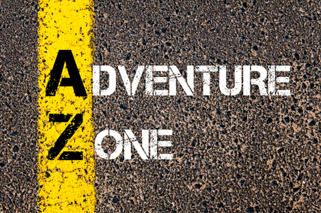 az: Concept image of Business Acronym AZ Adventure Zone written over road marking yellow paint line Stock Photo