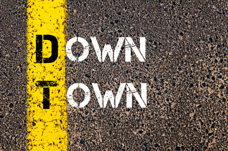 down town: Concept image of Business Acronym DT Down Town written over road marking yellow paint line Stock Photo