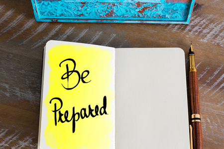 be prepared: Text Be Prepared handwritten on notebook
