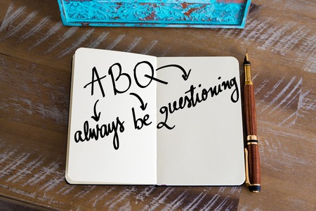 always: Business Acronym ABQ as Always Be Questioning handwritten on notebook