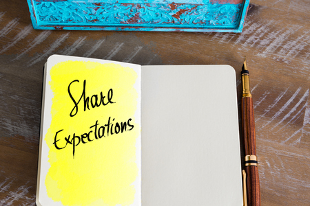 expectations: Text Share Expectations handwritten on notebook