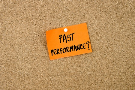 thumbtack: Past Performance written on orange paper note note pinned on cork board with white thumbtack, copy space available Stock Photo
