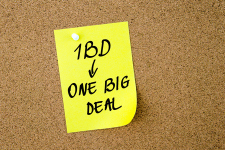 big deal: 1BD One Big Deal written on yellow paper note pinned on cork board with white thumbtacks, copy space available