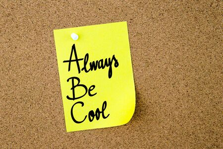 yellow thumbtacks: ABC Always Be Cool written on yellow paper note pinned on cork board with white thumbtacks, copy space available Stock Photo