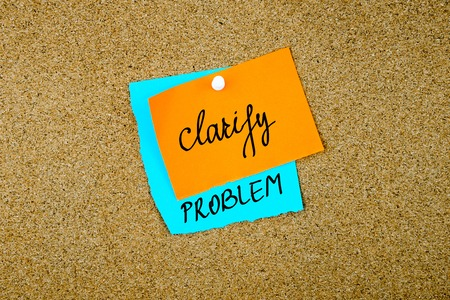 clarify: Clarify Problem written on paper notes pinned on cork board with white thumb tack, copy space available