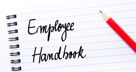 Employee Handbook written on notebook page with red pencil on the right
