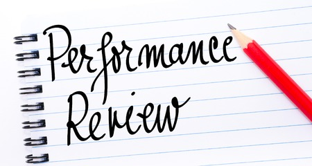 comunicación escrita: Performance Review written on notebook page with red pencil on the right Foto de archivo