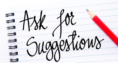 suggestions: Ask for Suggestions written on notebook page with red pencil on the right Stock Photo