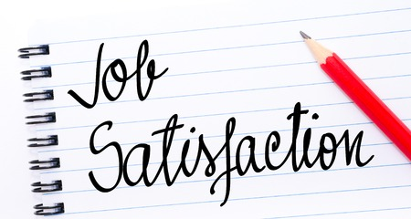 job satisfaction: Job Satisfaction written on notebook page with red pencil on the right