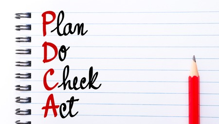 plan do check act: PDCA Plan Do Check Act written on notebook page with red pencil on the right