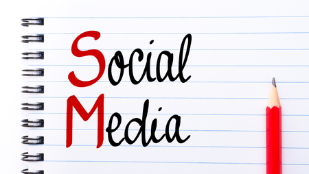 sm: SM Social Media written on notebook page with red pencil on the right