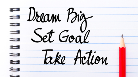 comunicación escrita: Dream BIG, Set GOAL, Take ACTION written on notebook page with red pencil on the right