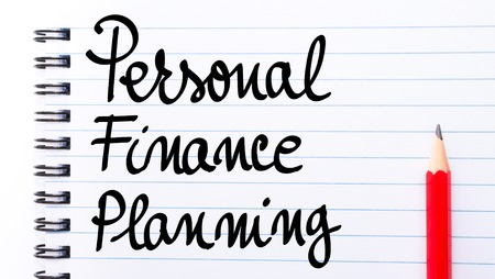 personal finance: Personal Finance Planning written on notebook page with red pencil on the right