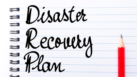 drp: DRP Disaster Recovery Plan written on notebook page with red pencil on the right