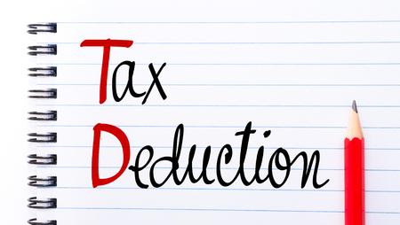 「ノートブック」ページ右側に赤鉛筆で書かれた TD 税額控除 写真素材