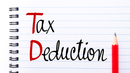 TD Tax Deduction written on notebook page with red pencil on the right Stock Photo