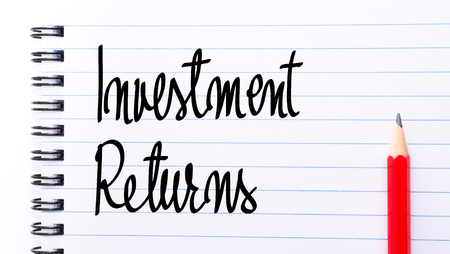returns: Investment Returns written on notebook page with red pencil on the right