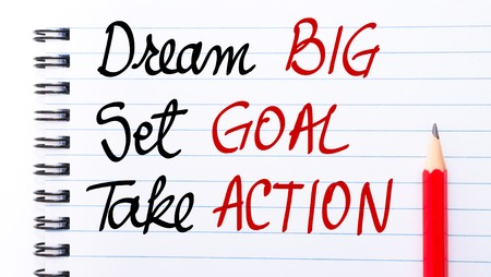 set goal: Dream BIG, Set GOAL, Take ACTION written on notebook page with red pencil on the right