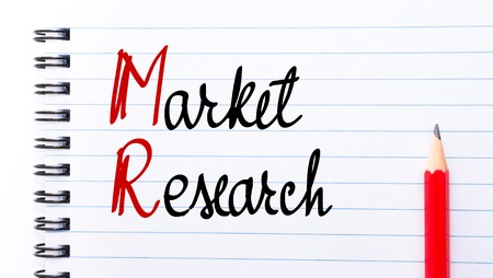 mr: MR Market Research written on notebook page with red pencil on the right Stock Photo
