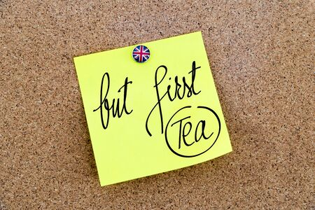 great britain flag: Yellow paper note pinned on cork board with Great Britain flag thumbtack, written text But First Tea, British Business concept