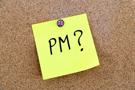 pm: Yellow paper note pinned on cork board with Great Britain flag thumbtack, written text PM as Prime Minister, British Business concept Stock Photo
